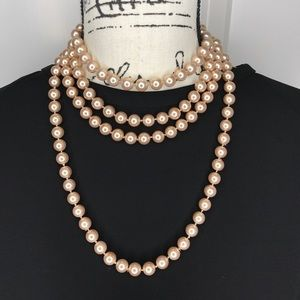 "Versatile 60"" champagne colored pearl rope"